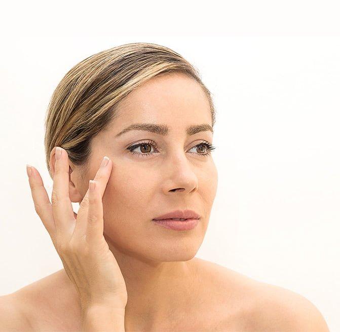 women examining skin